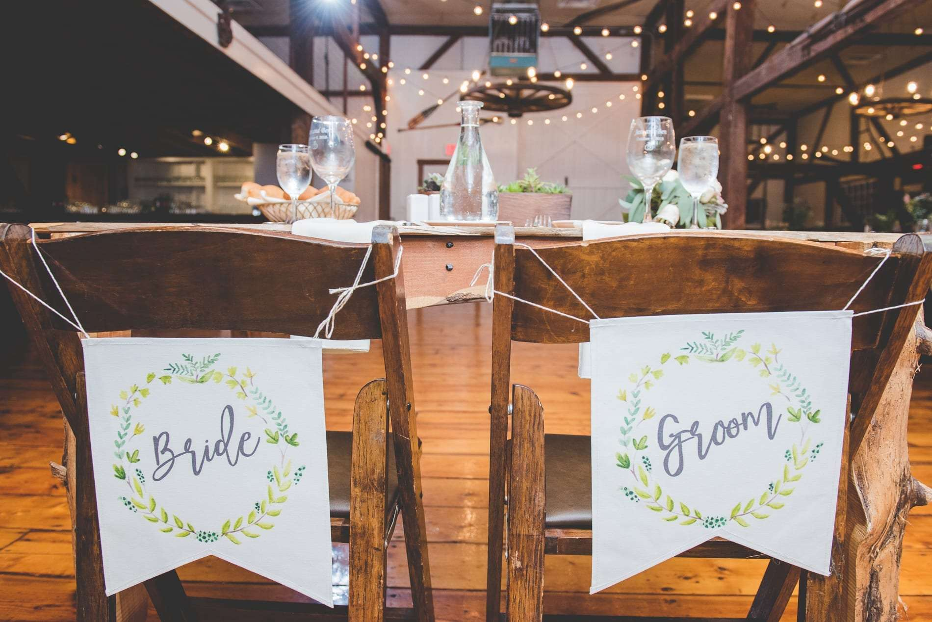 Bride and groom signs for chairs