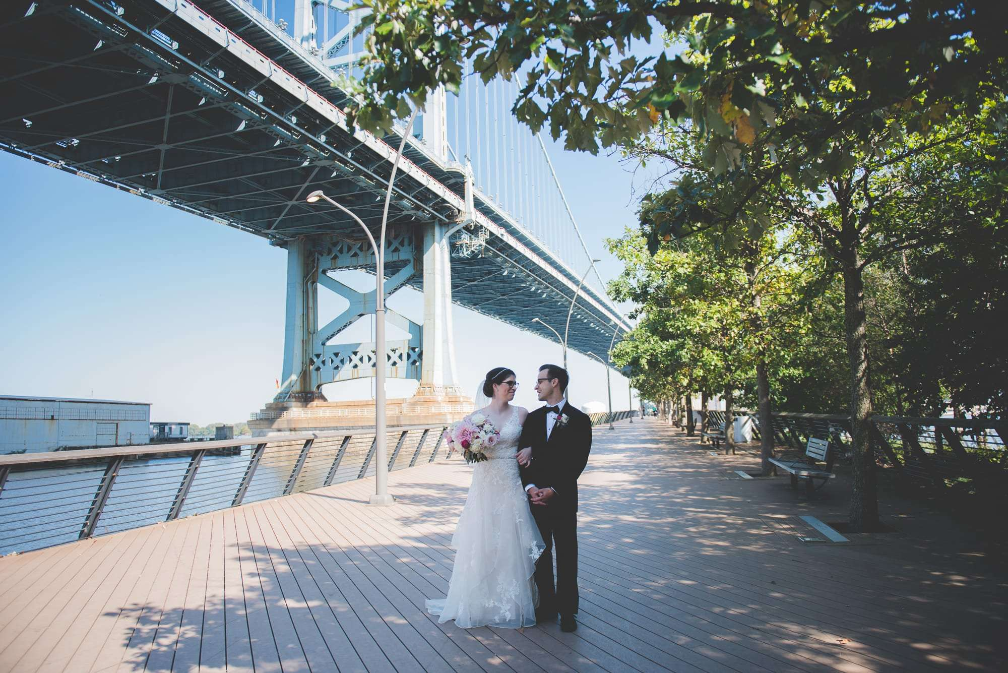 Bride and groom portraits at race street pier philadelphia