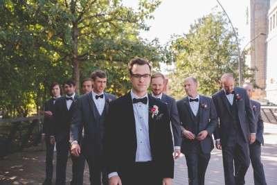 groom photos at race street pier philadelphia