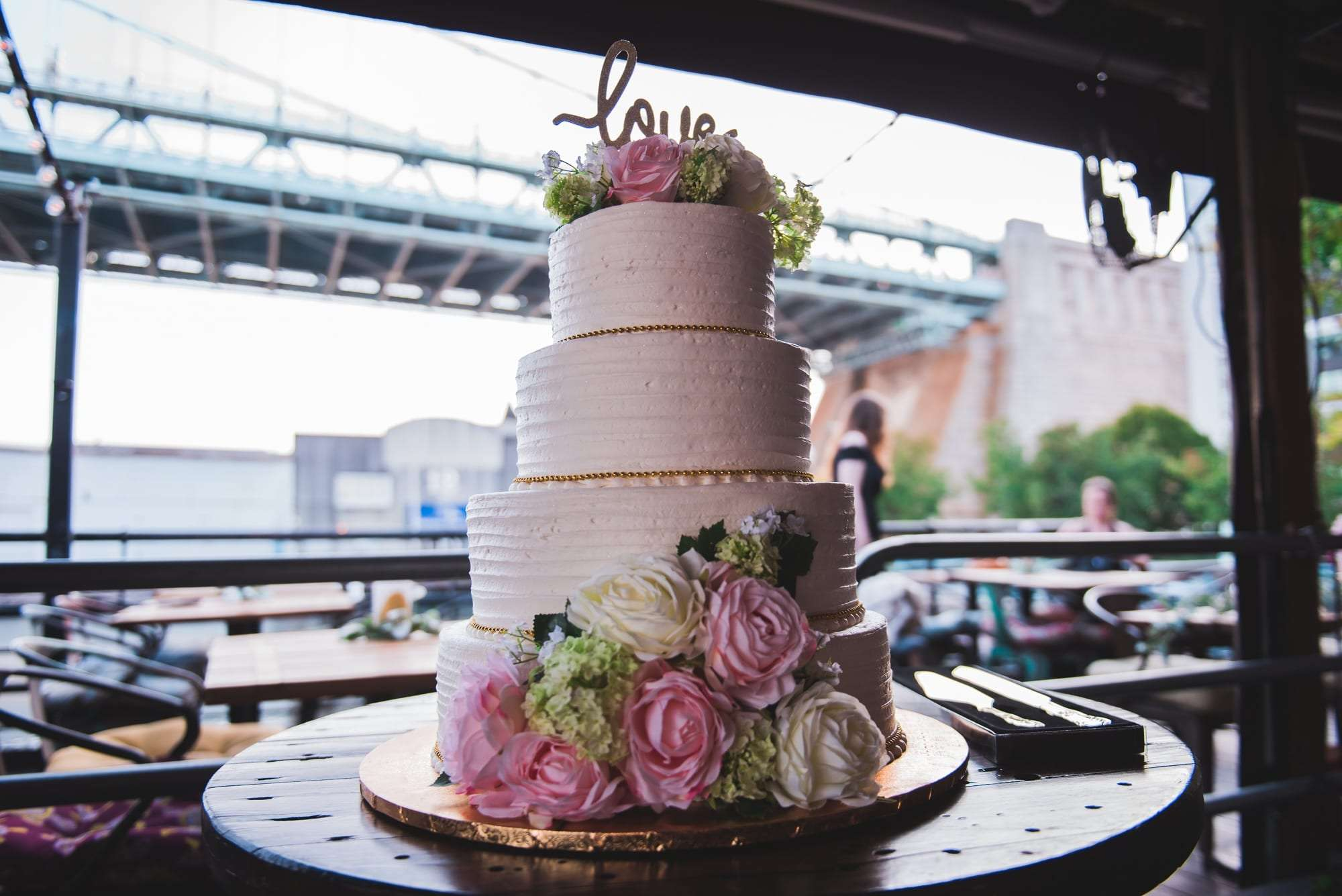 Morgan street pier philadelphia wedding cake with flowers