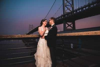 view of bed franklin bridge wedding photos sunset