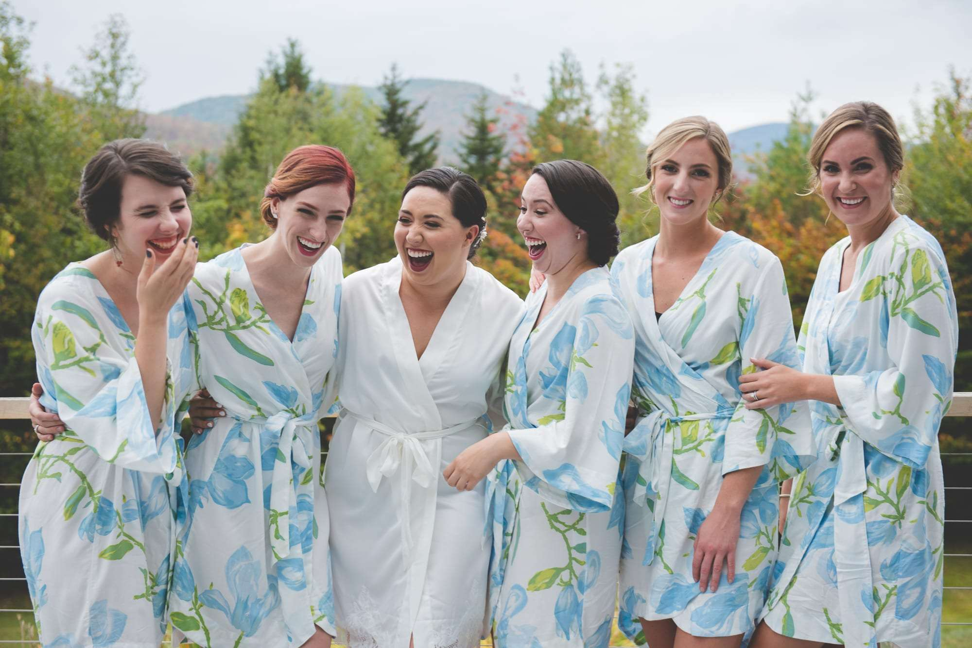 Bride and bridesmaids in robes Vermont wedding photographer
