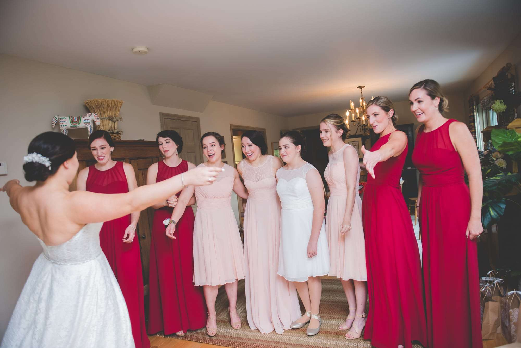 Bridesmaids seeing bride in dress VT wedding photographer
